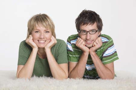 interiour shots: Couple lying on carpet, portrait