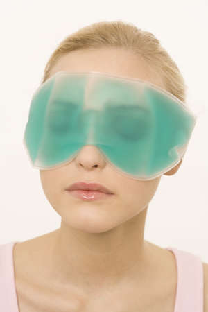 interiour shots: Young Woman Wearing a Gel Eye Mask, portrait
