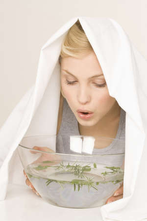 inhale: Young woman inhaling vapors, portrait