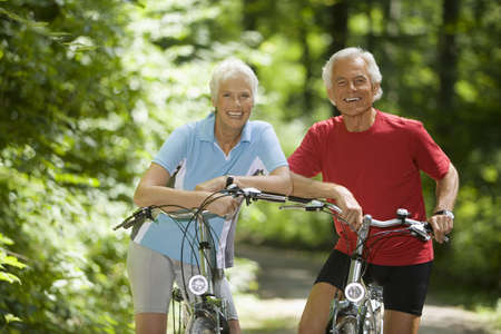 bicycling: Senior couple with bikes, smiling, portrait