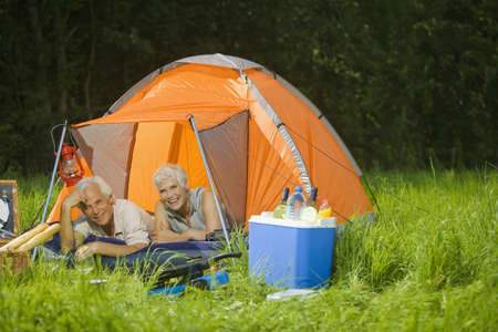 60 64 years: Senior couple camping, portrait