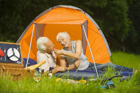 60 64 years: Senior couple camping, having a picnic, portrait