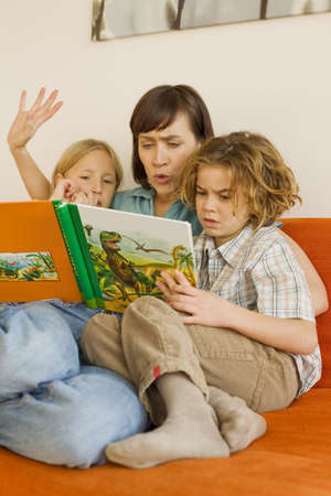 Mother reading story book to children Stock Photo - 23891325
