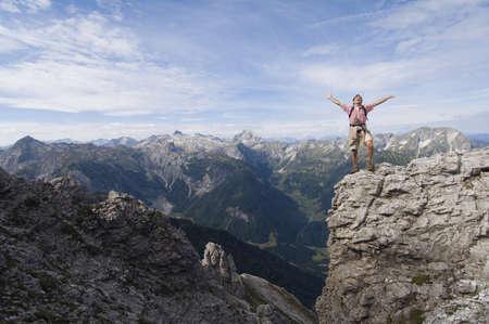 hauteur: Austria, Salzburger Land, young man cheering LANG_EVOIMAGES