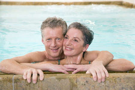 Mature couple embracing in swimmingpool, portrait Stock Photo - 23891362