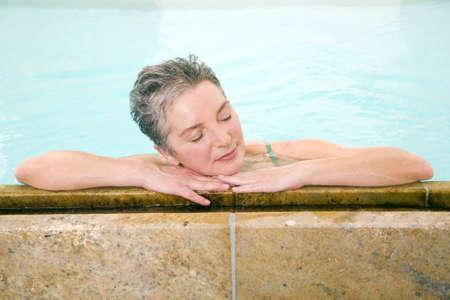 swimmingpool: Mature woman in swimmingpool, portrait