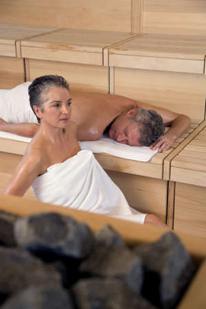 body consciousness: Mature couple in sauna LANG_EVOIMAGES