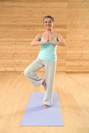 Senior woman exercising yoga, portrait Stock Photo - 23891370