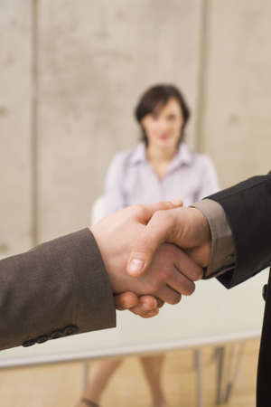 interiour shots: Business people shaking hands