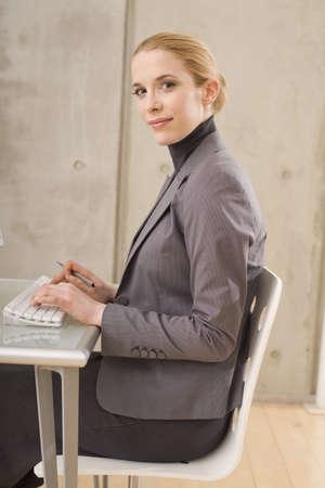 everyday jobs: Businesswoman using a computer, portrait