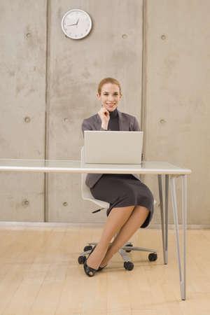 interiour shots: Businesswoman using a laptop, portrait