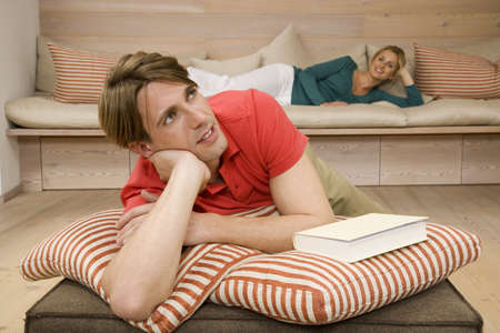 Young couple relaxing in living room, portrait Stock Photo - 23891412