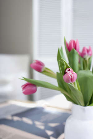 interiour shots: Tulips in flower vase