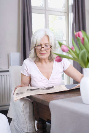 Senior woman reading newspaper, portrait Stock Photo - 23891442