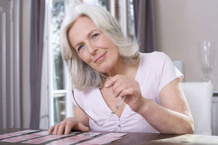 Senior woman playing Solitaire, portrait Stock Photo - 23891443