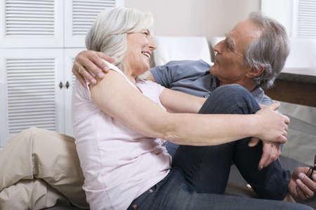 55 59 years: Senior couple embracing, portrait