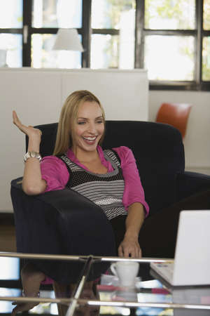 interiour shots: Young business woman in office, laughing