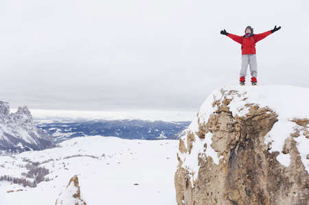 mountaintops: Italy, South Tyrol, Woman in winter clothes on mountain top, cheering LANG_EVOIMAGES