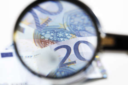 20 euro: 20 Euro banknotes under magnifying glass, close-up