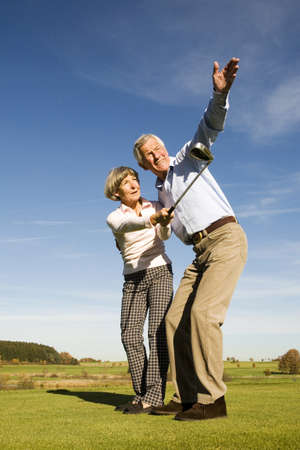 only seniors: Germany, Bavaria, senior couple playing golf LANG_EVOIMAGES