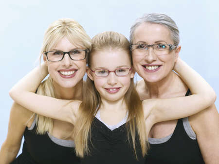grizzled: Grandmother, mother and daughter wearing spectacles, portrait