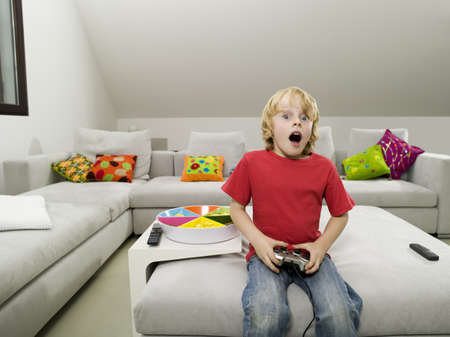 Boy playing computer game Stock Photo - 24276874