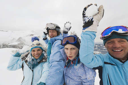 четыре человека: Italy, South Tyrol, Four people in winter clothes, holding snowballs