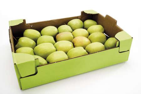 juxtaposing: Apples in paperboard box, elevated view LANG_EVOIMAGES