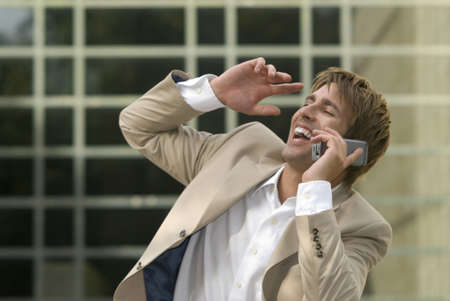 Businessman using mobile phone, laughing, close-up Stock Photo - 24303116