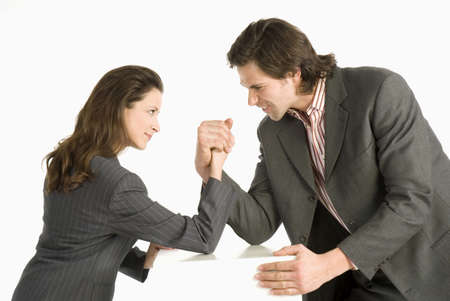 dissension: Businessman and businesswoman arm-wrestling, side view