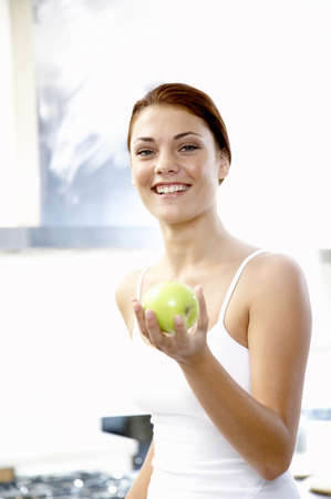 accrued: Young woman holding apple