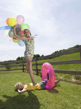 dido: Girl, holding balloons, jumping over boy