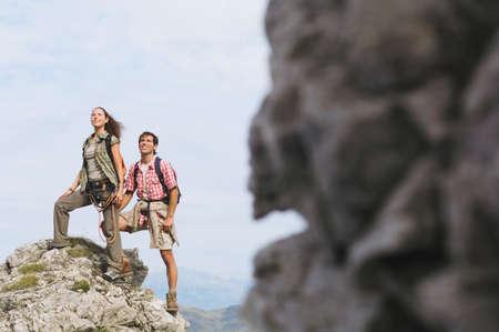 hauteur: Austria, Salzburger Land, couple on mountain top