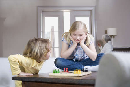 easygoing: Boy (8-9) and girl (8-9) playing together