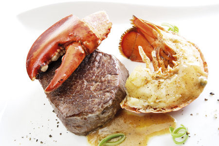 Surf and turf, filet steak with seafood photo