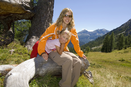 Austria, Salzburger Land, mother and daughter taking a break photo