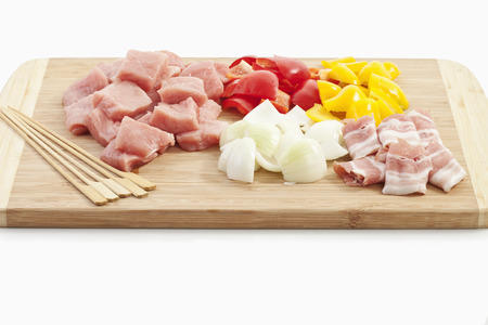 Meat and vegetables are used for preparing meat skewer photo