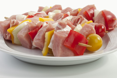 Meat and vegetables are used for preparing meat skewer in plate photo