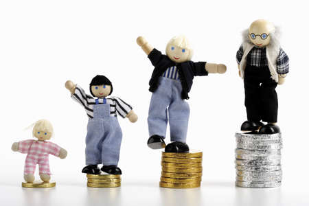 easygoing: Figurines standing on piles of coins