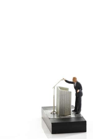 businesspersons: Businessman figurine standing behind a podium LANG_EVOIMAGES