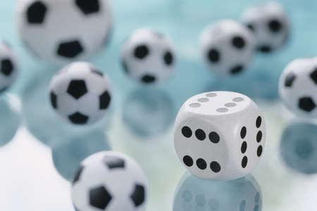 auspiciousness: Dice and football toys