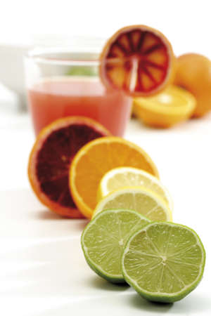 citrons: Various citrus fruits by glass of juice