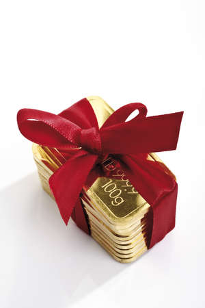 conformance: Gold bars with red bow