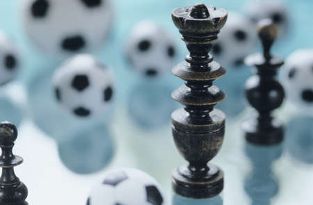 strategical: Soccer and chess pieces