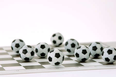 strategical: Footballs on a chessboard