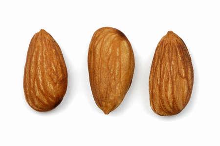 juxtaposing: Three almonds