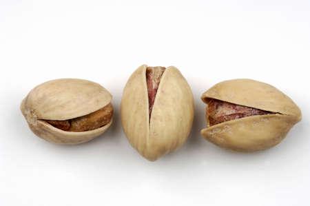 juxtaposing: Three pistachio nuts