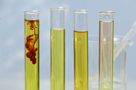 natural sciences: Test tubes with coloured liquid, close-up