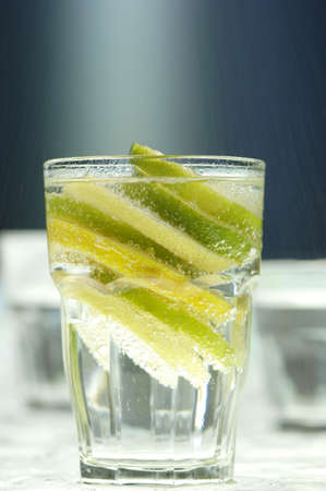 citrous: Lemon and lome slices in glass of water LANG_EVOIMAGES