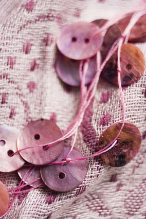 confiding: Pink buttons,close-up